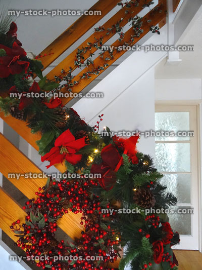 stock image of christmas hall decorations with wreath artificial spruce garland