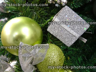 Fake christmas tree with green and silver decorations