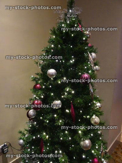stock image of christmas tree decorations white fairylights purple silver baubles
