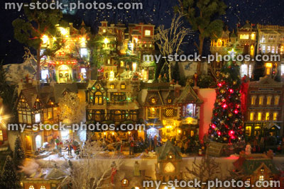 stock image of model christmas village with miniature houses people winter scene night