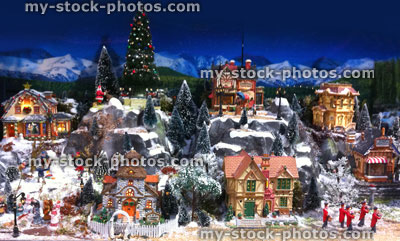 stock image of model christmas village with miniature houses people winter scene