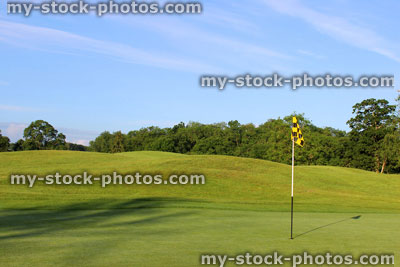 Stock photo of a golf course putting green.